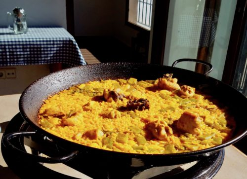 A paella pan with traditional paella valenciana
