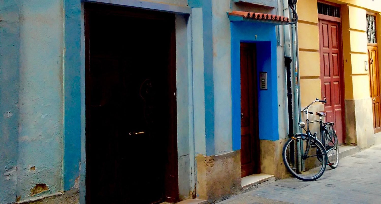Bicycle locked in a colorful old city street
